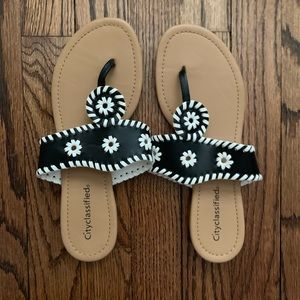 Black and white sandals with embroidered design